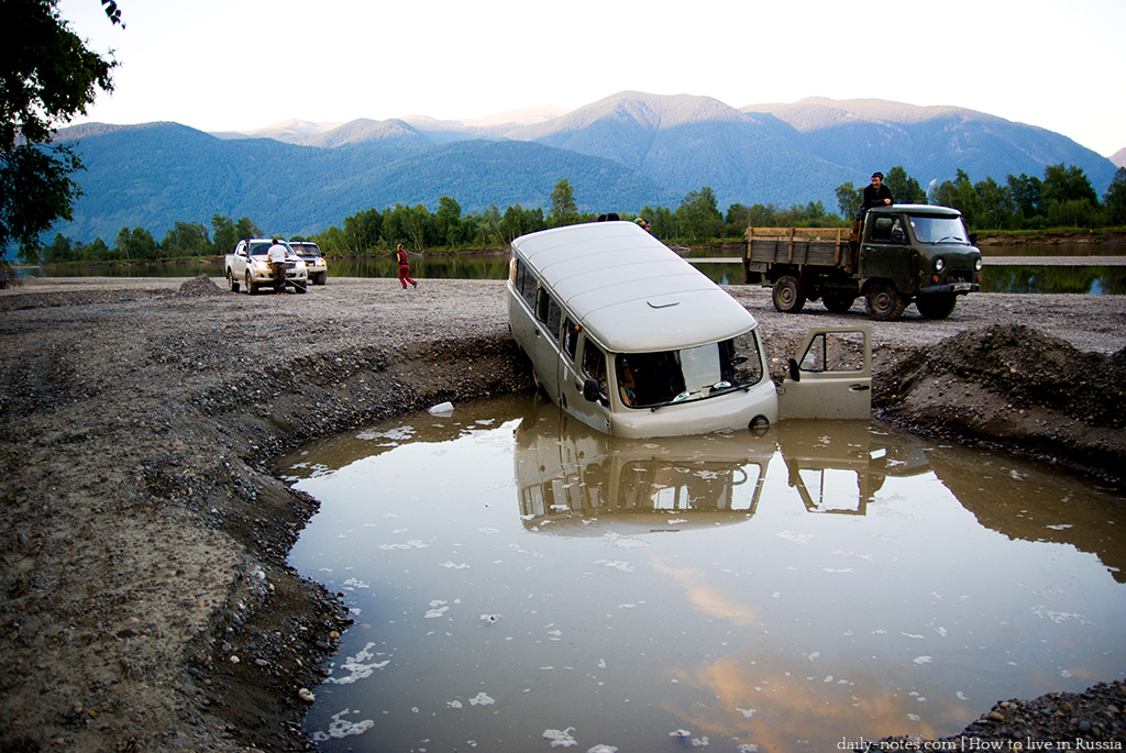 Uaz sunk in a large puddle