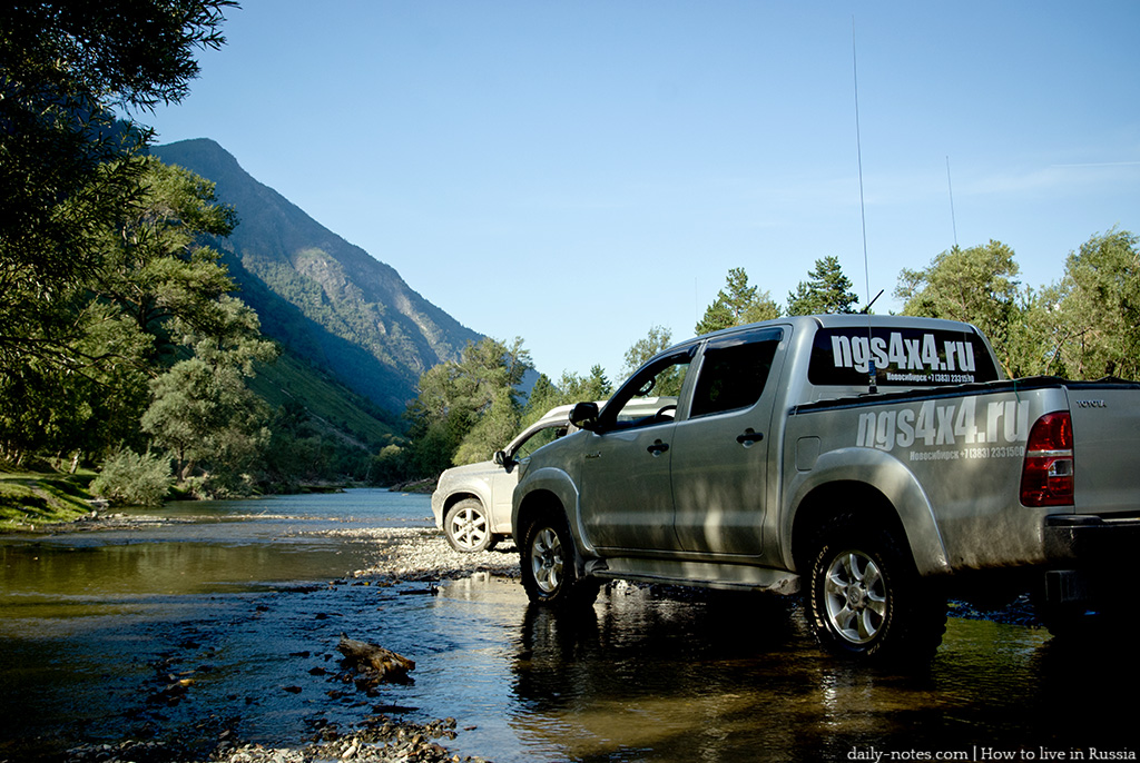Hilux in a shallow river